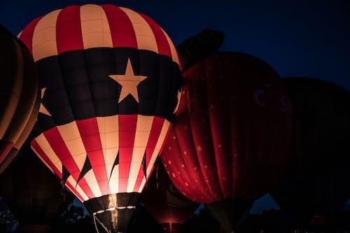 Row of Air Balloons at Night