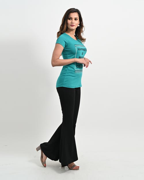 Woman in Teal Tank Top and Black Pants