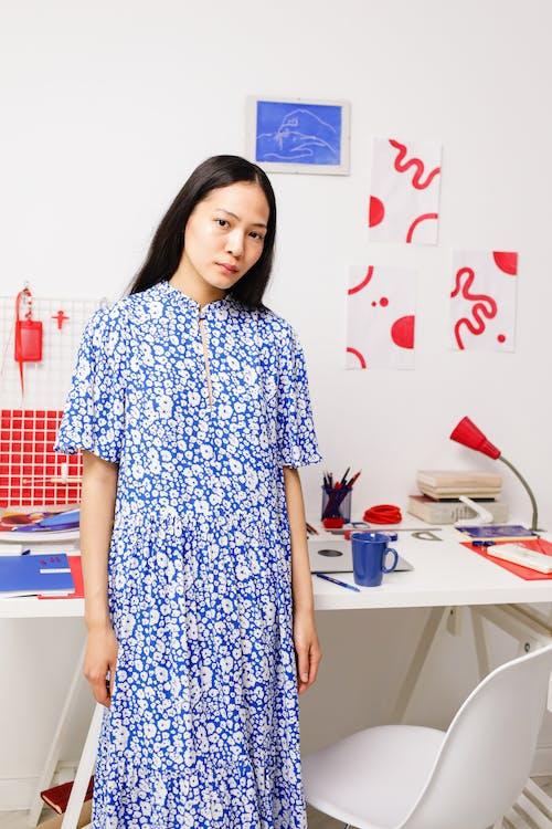 Portrait of Woman in Blue Dress in Home Office