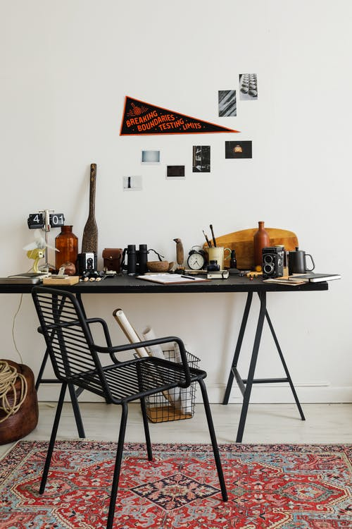 Desk with Lots of Objects in Home Office