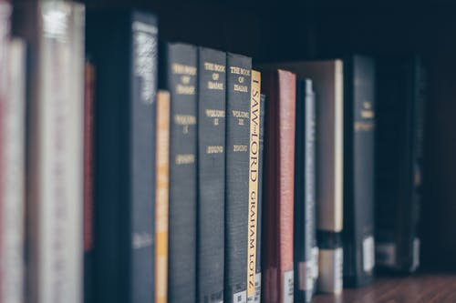 Photos gratuites de bibliothèque, étagère, livres, reliures de livres