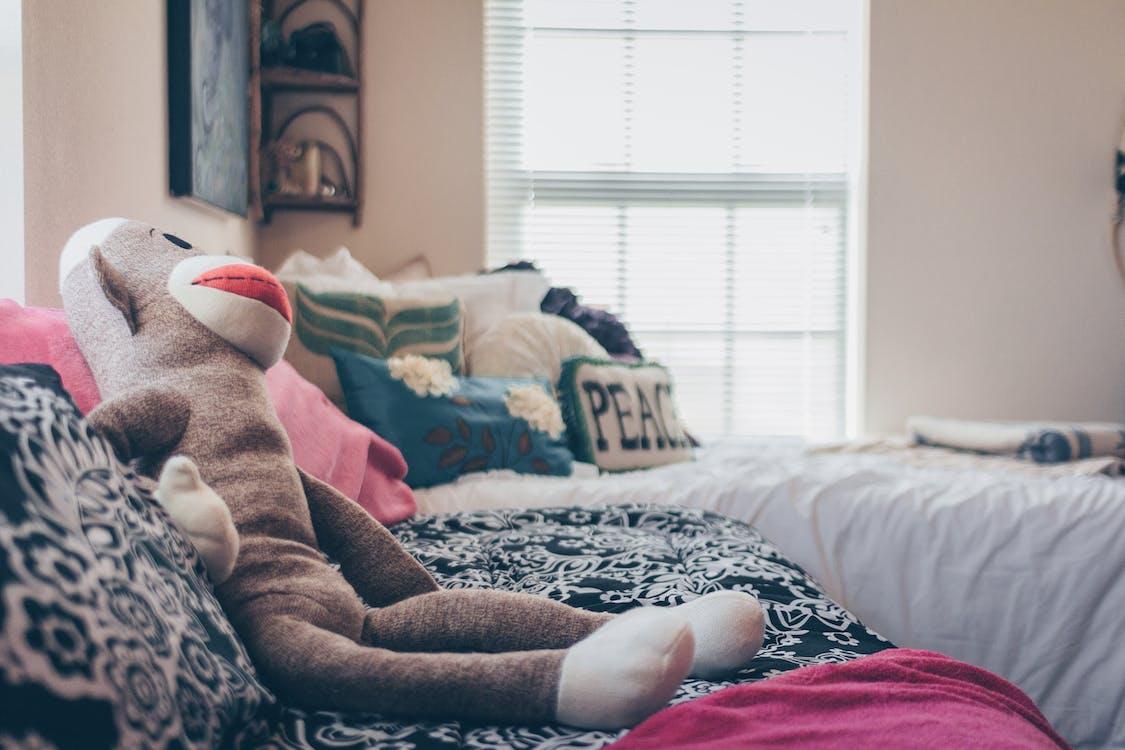 Sock Monkey Plush Toy On Bed