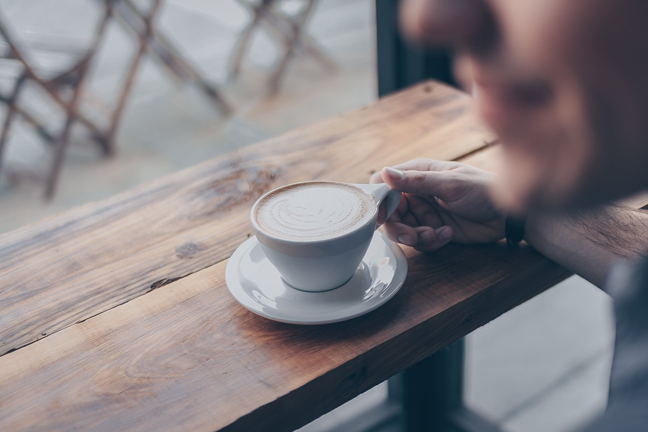 Person Holding White Mug Filled With Coffee