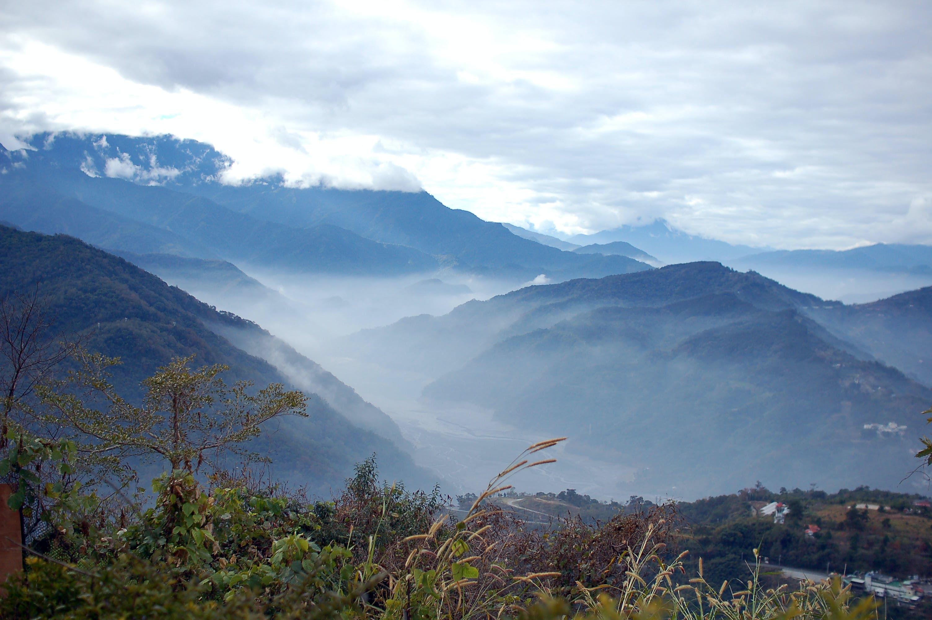 Photography of Mountain Under White Clouds during Daytije