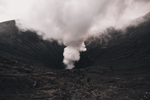 Landscape of Volcanic Crater With Smoke