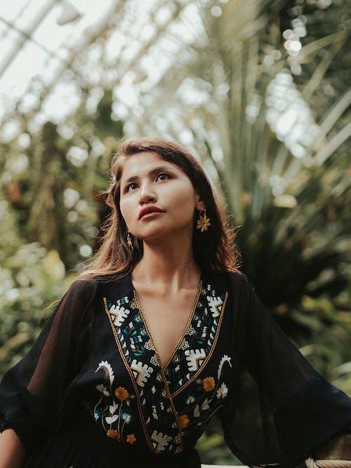 Portrait of Woman Against Green Plants