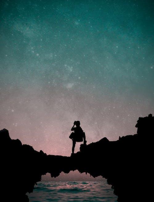 Free stock photo of amazing sky, boy, boy on mountains, dark