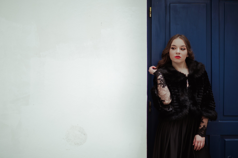 Woman Leaning on Blue Door
