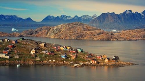 Houses Near Lake and Mountains