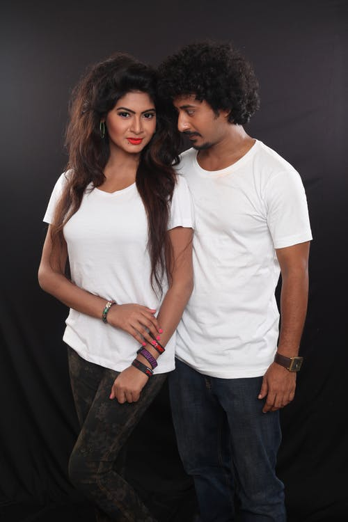 Man and Woman Wearing White Crew-neck T-shirts