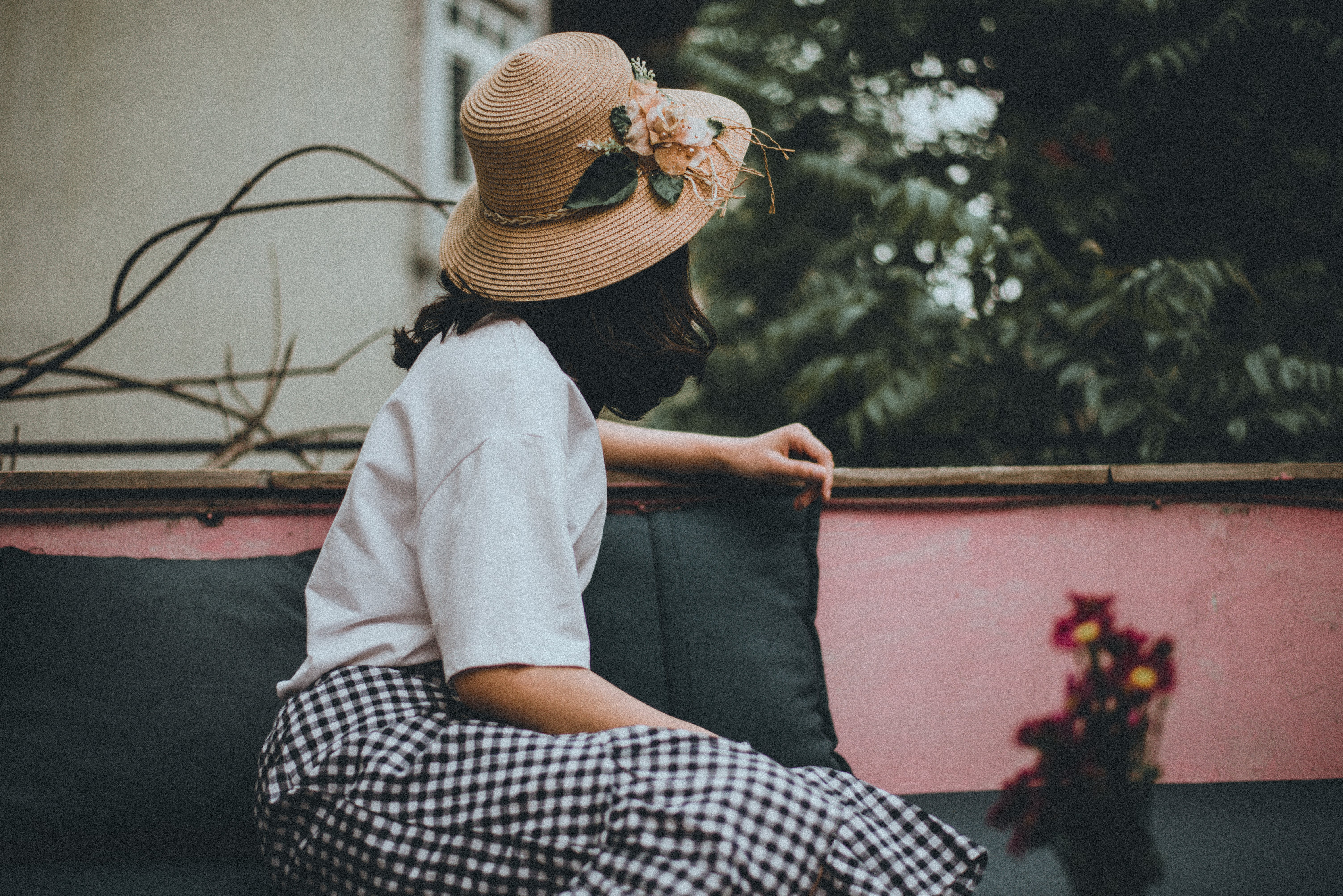Woman Wearing Sun Hat Looking Backward