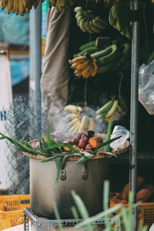Fruits and Vegetables on Pot on Market Stall