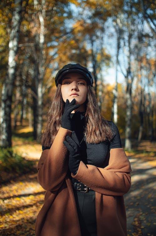 Portrait of Woman in Park in Autumn