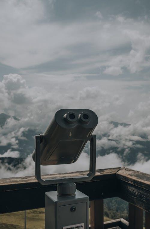 Gray Binoculars Under White Clouds
