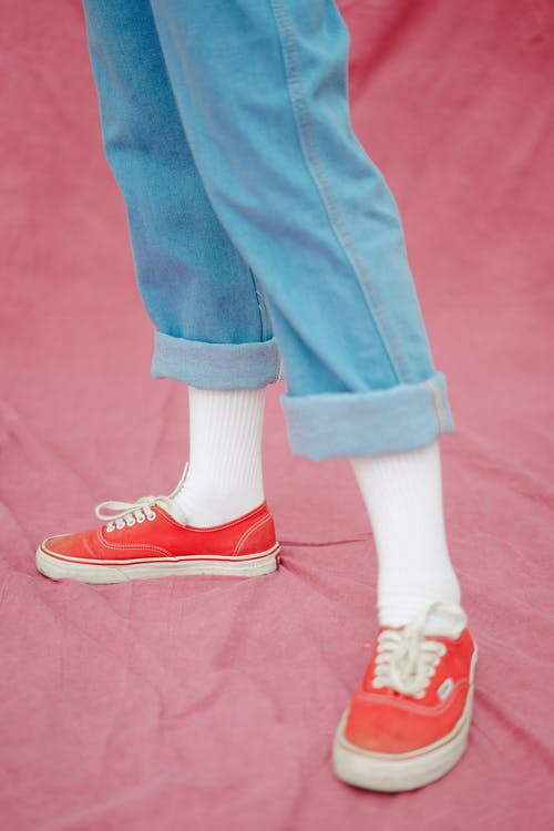 Close up on Legs in Jeans and Red Shoes