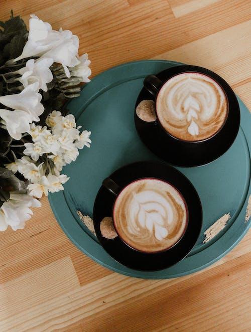 Two Black Ceramic Cups With Espresso