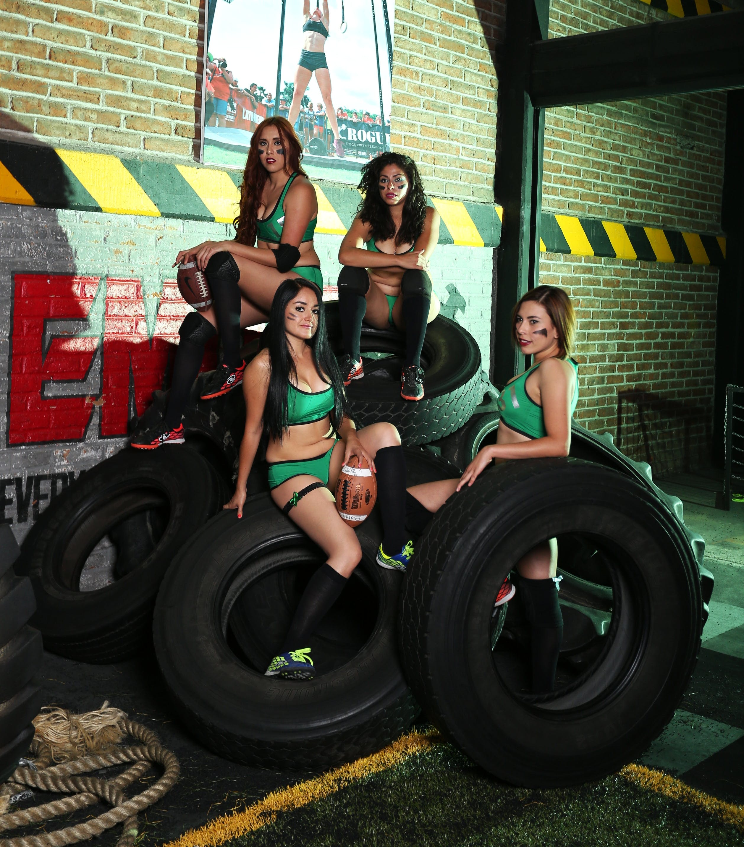 Four Women Sitting and Standing on Vehicle Tires