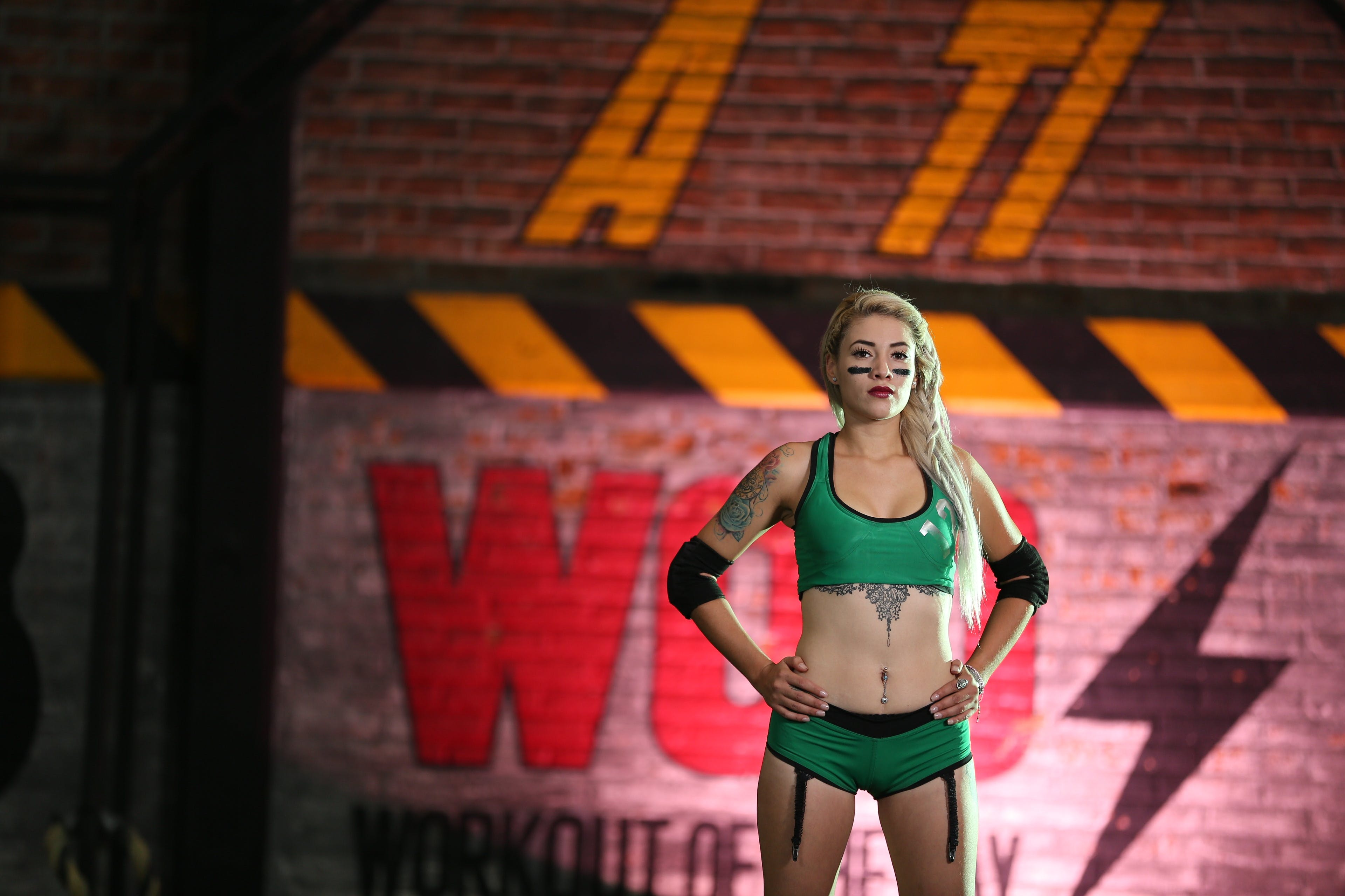 Woman Wearing Green Sports Bra and Bottoms