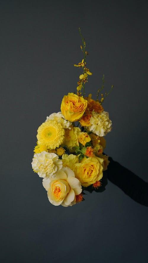 Hand Holding Flower Arrangement