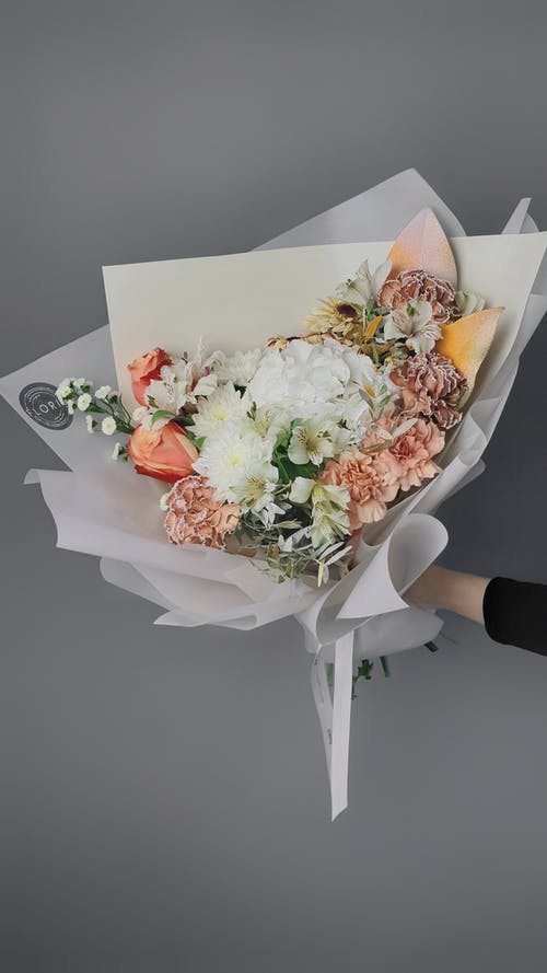 Hand Holding Flower Bouquet