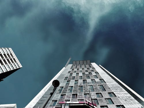 Worms Eye-view Photography of White High-rise Building during Storm Weather