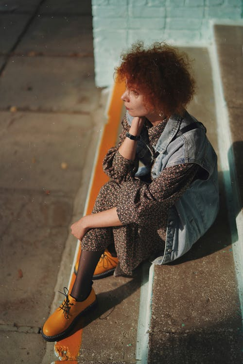 High Angle View of Redhead Woman Sitting on Stairs