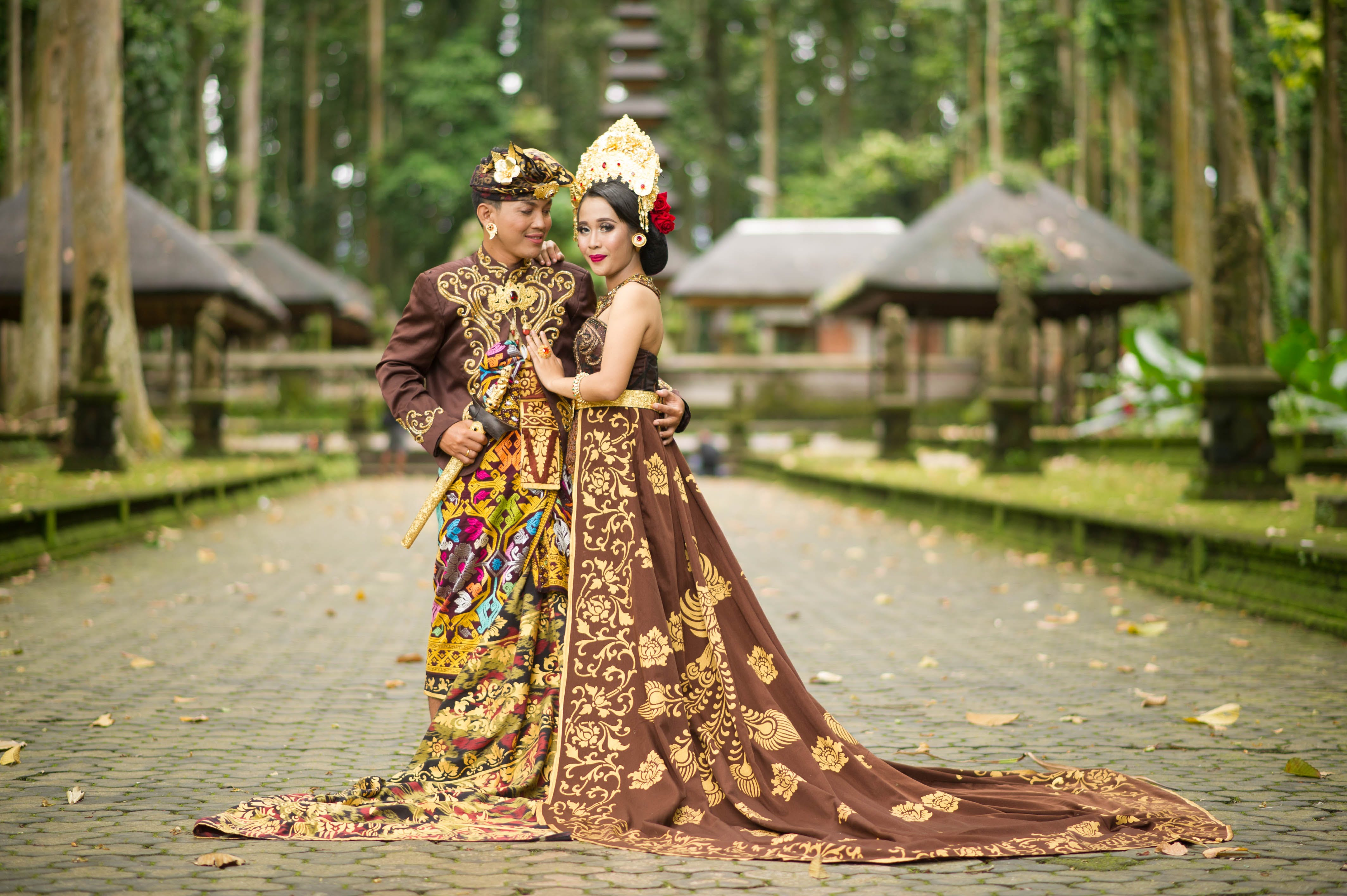 Photo of Man and Woman Wearing Brown Floral Dress
