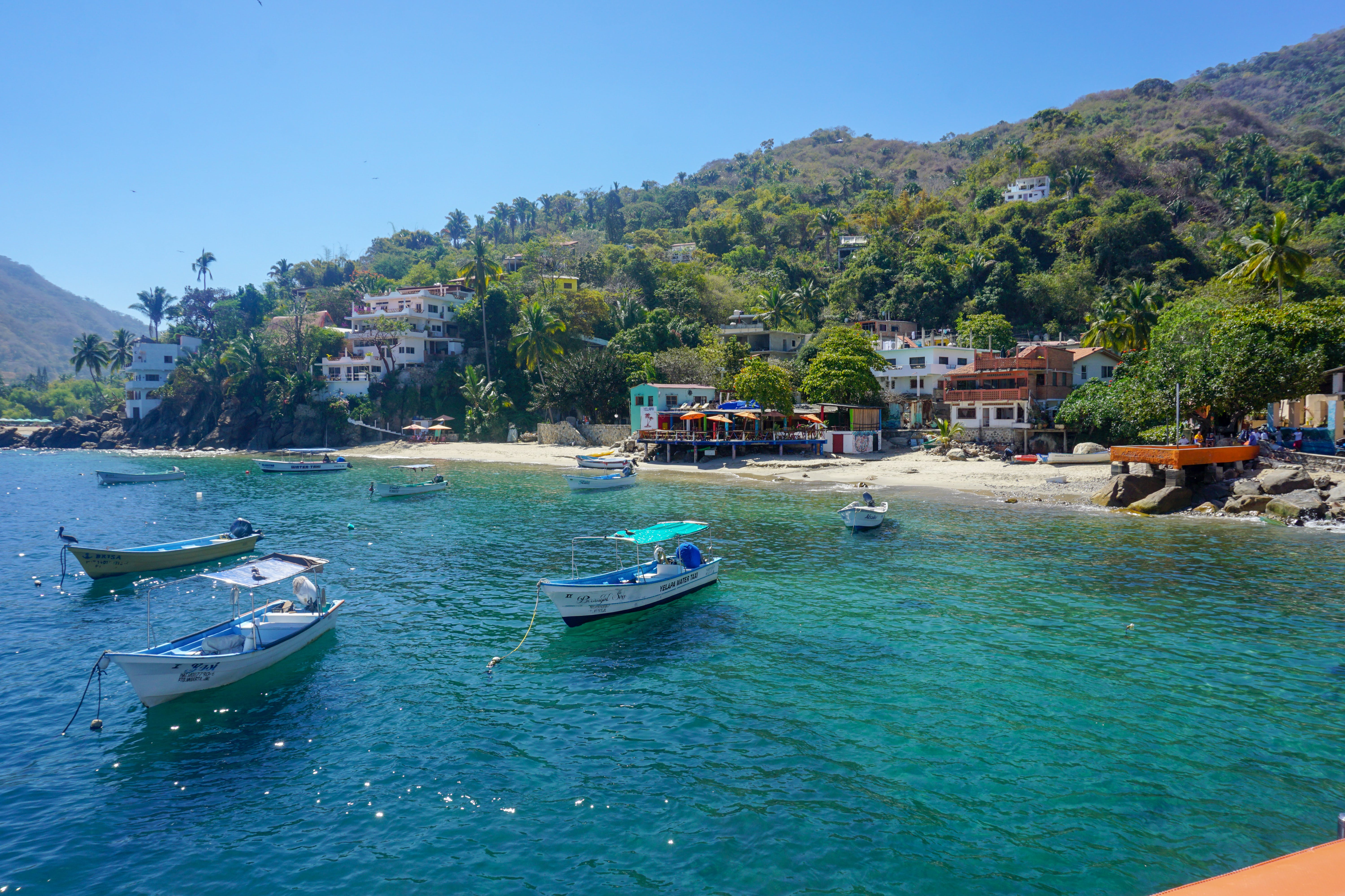 Free stock photo of beach, boats, hill, houses
