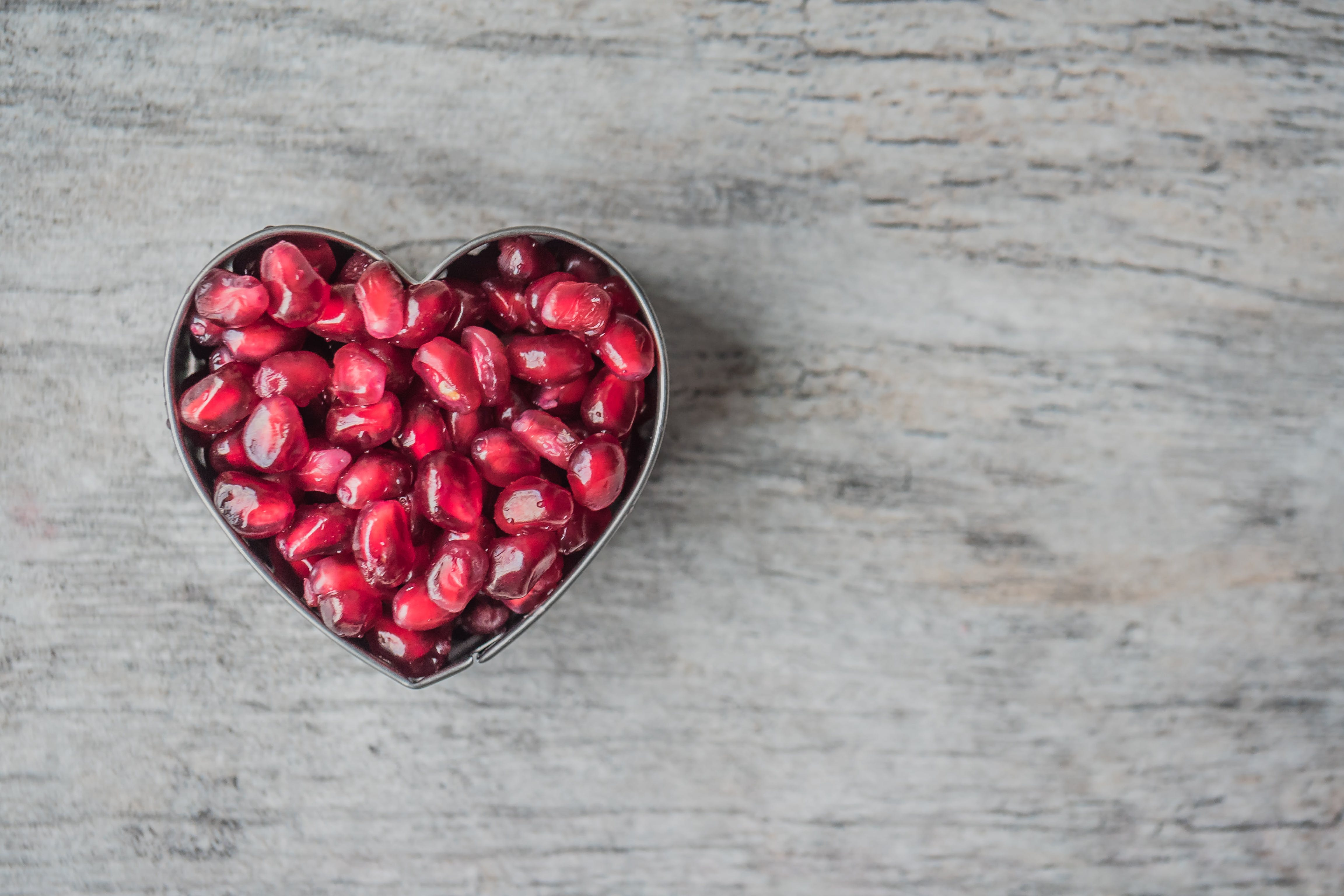Silver Heart Bowl Filled of Red Pomegranate Seeds