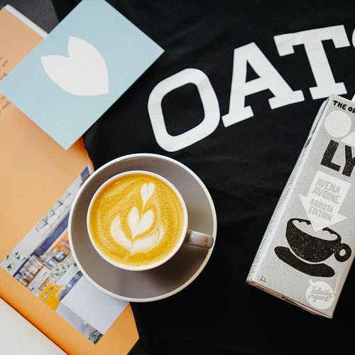 Flat Lay Shot of Coffee and Oat Milk