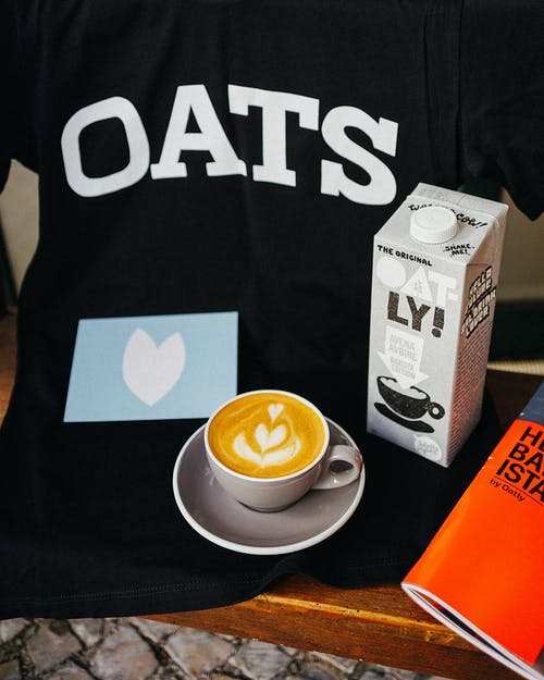 Coffee and Oat Milk on Table