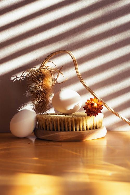 Gold and White Egg on Brown Woven Basket