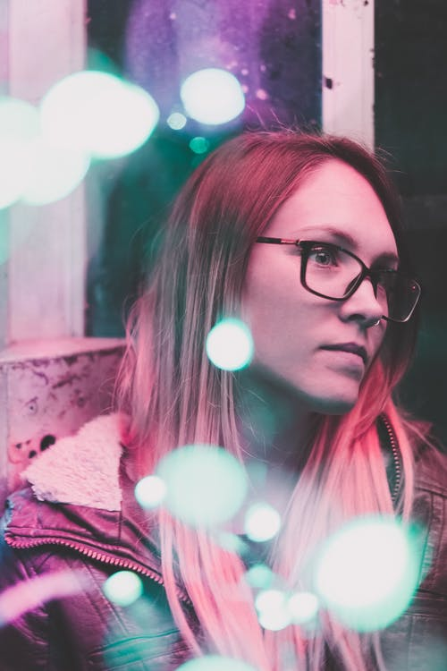 Bokeh Photo of Woman Wearing Eyeglasses