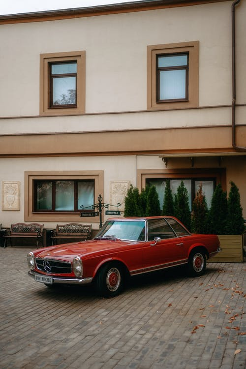 Old Red Mercedes Parked Near Building