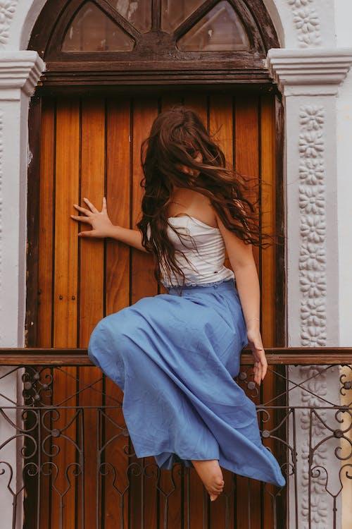 Portrait of Woman Against Wooden Door