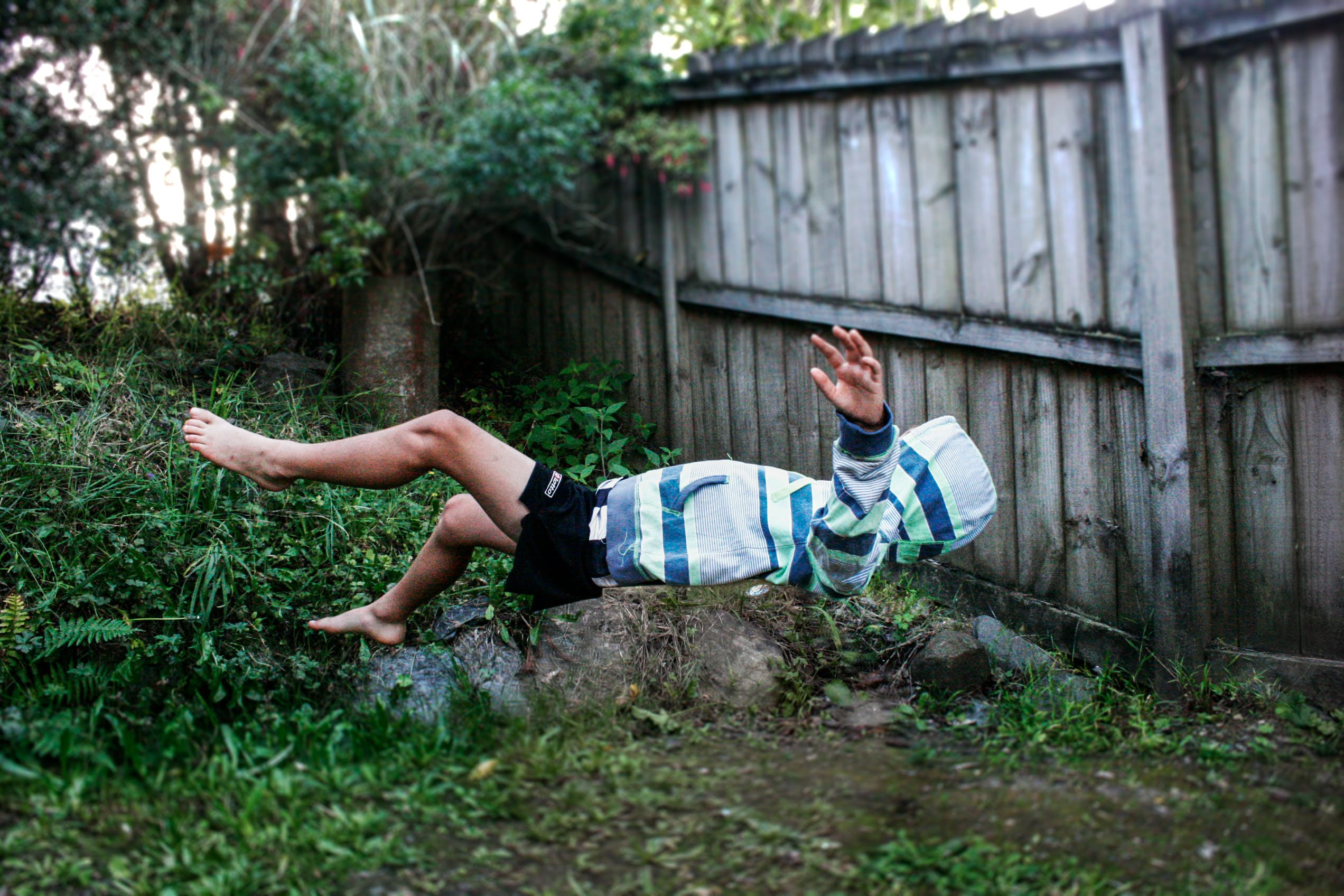Floating Photography of Man in White and Blue Striped Top