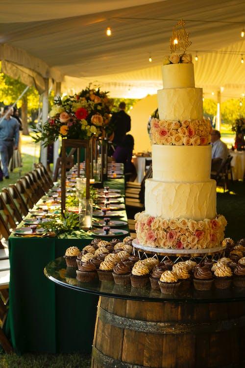 Wedding Cake and Cupcakes on Barrel