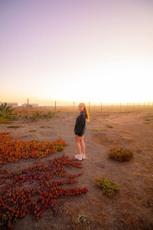 Girl Standing near Airport at Sunset