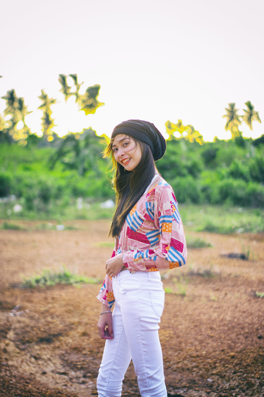 Woman Wearing Black Beanie Standing on Brown Soil Field
