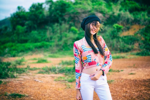 Photo of Woman Wearing Colorful Top