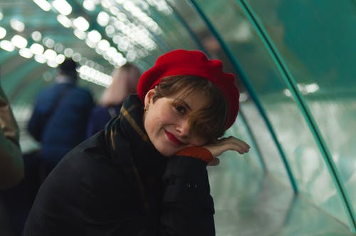 Smiling Woman in Red Beret