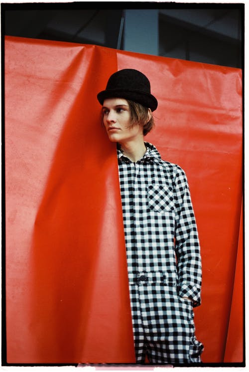 Woman in Black and White Checkered Dress Shirt Wearing Black Hat