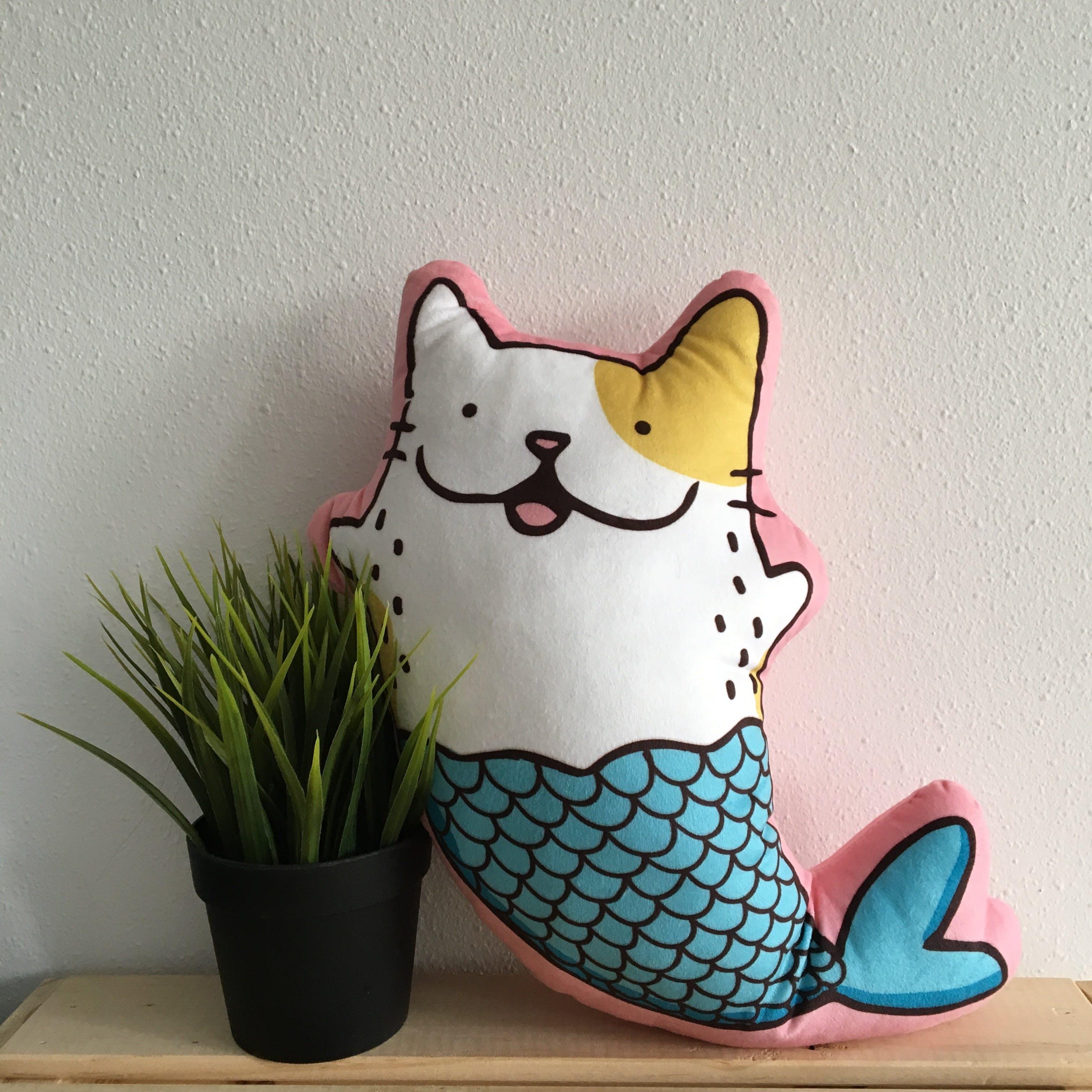 Mermaid Cat Pillow Beside Plant