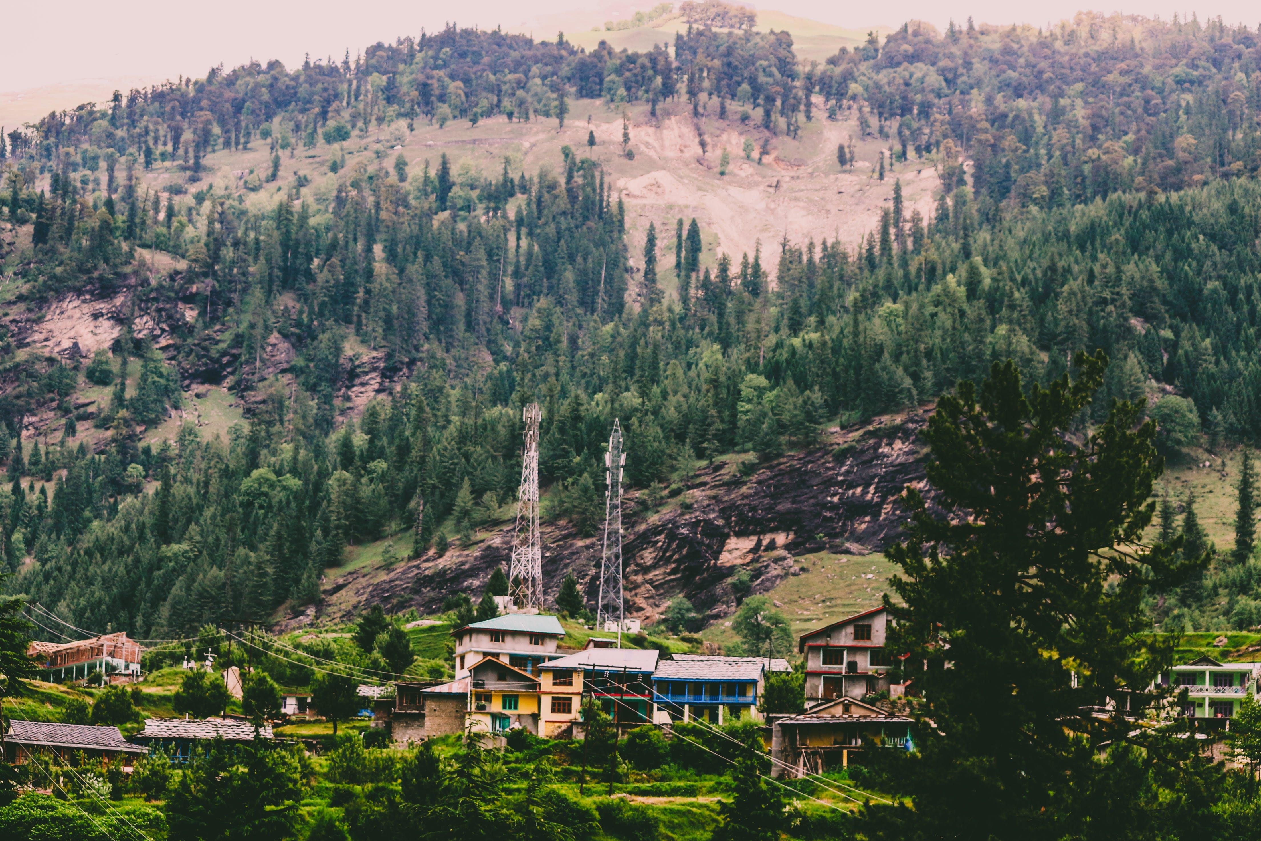 Free stock photo of green field, hills, hillside, house