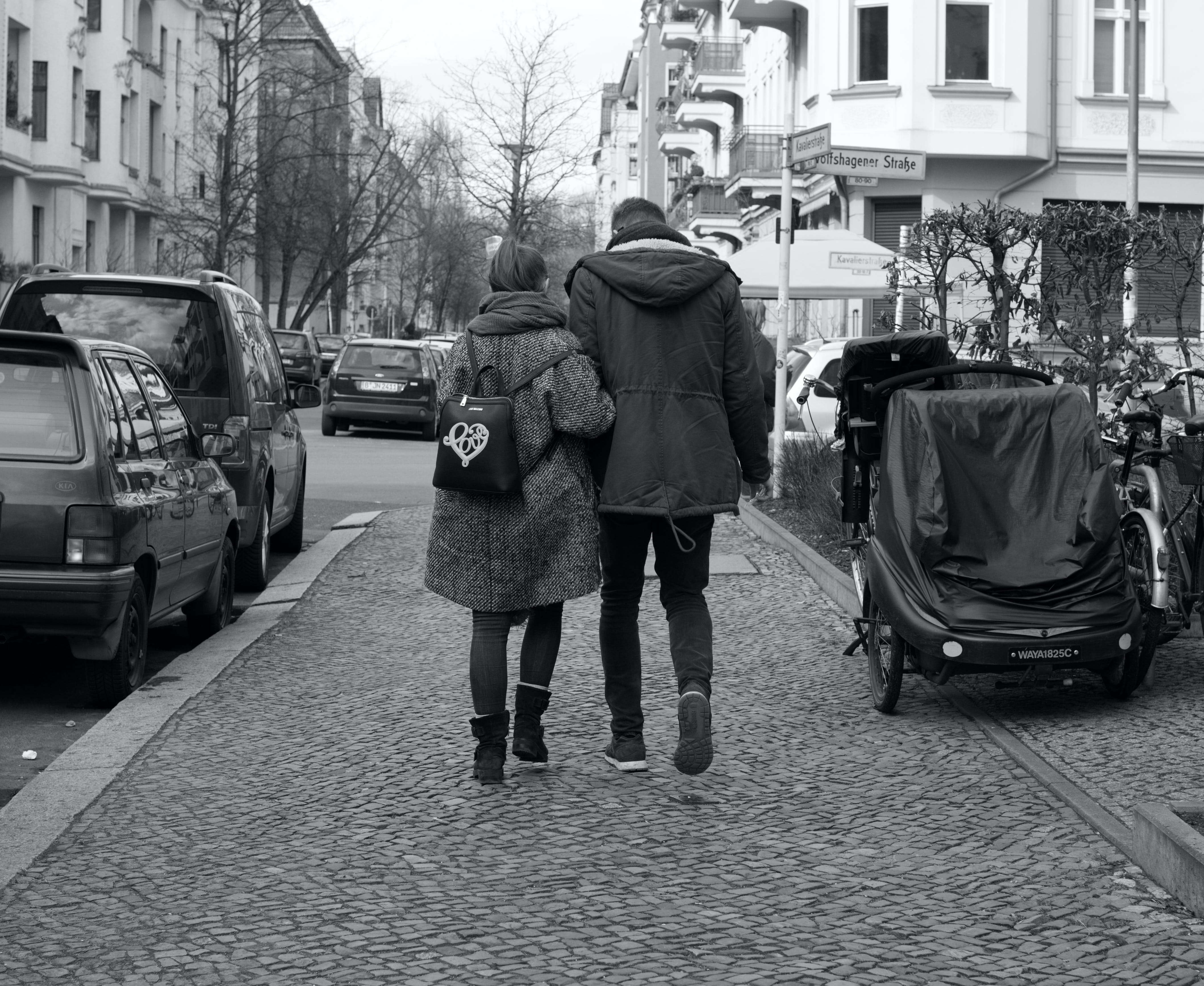 Free stock photo of berlin, black and white, couple walking, in love