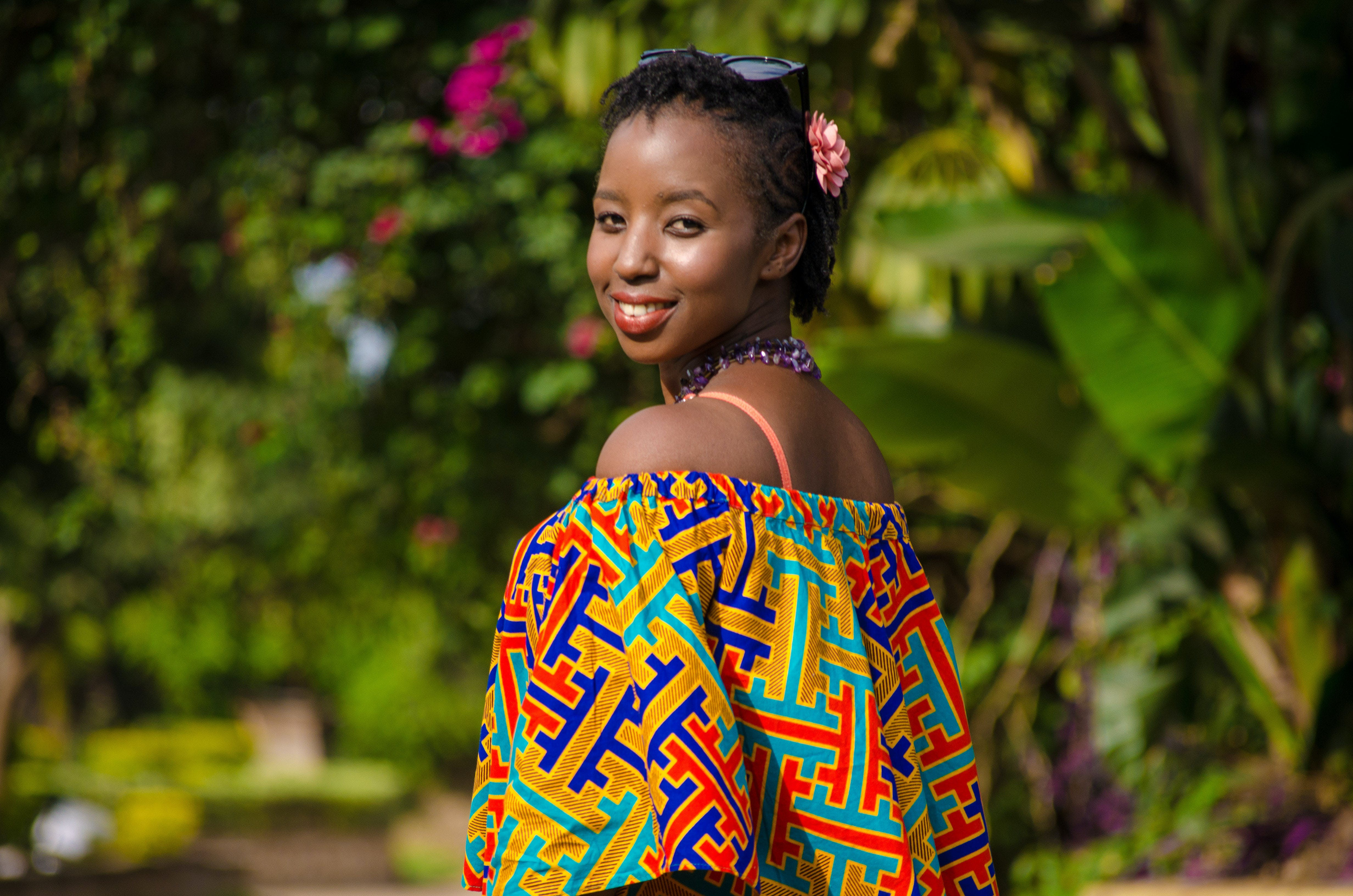 Shallow Focus Photography of Woman Wearing Multicolored Off-shoulder Top