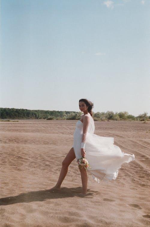 Woman in White Dress on Desert