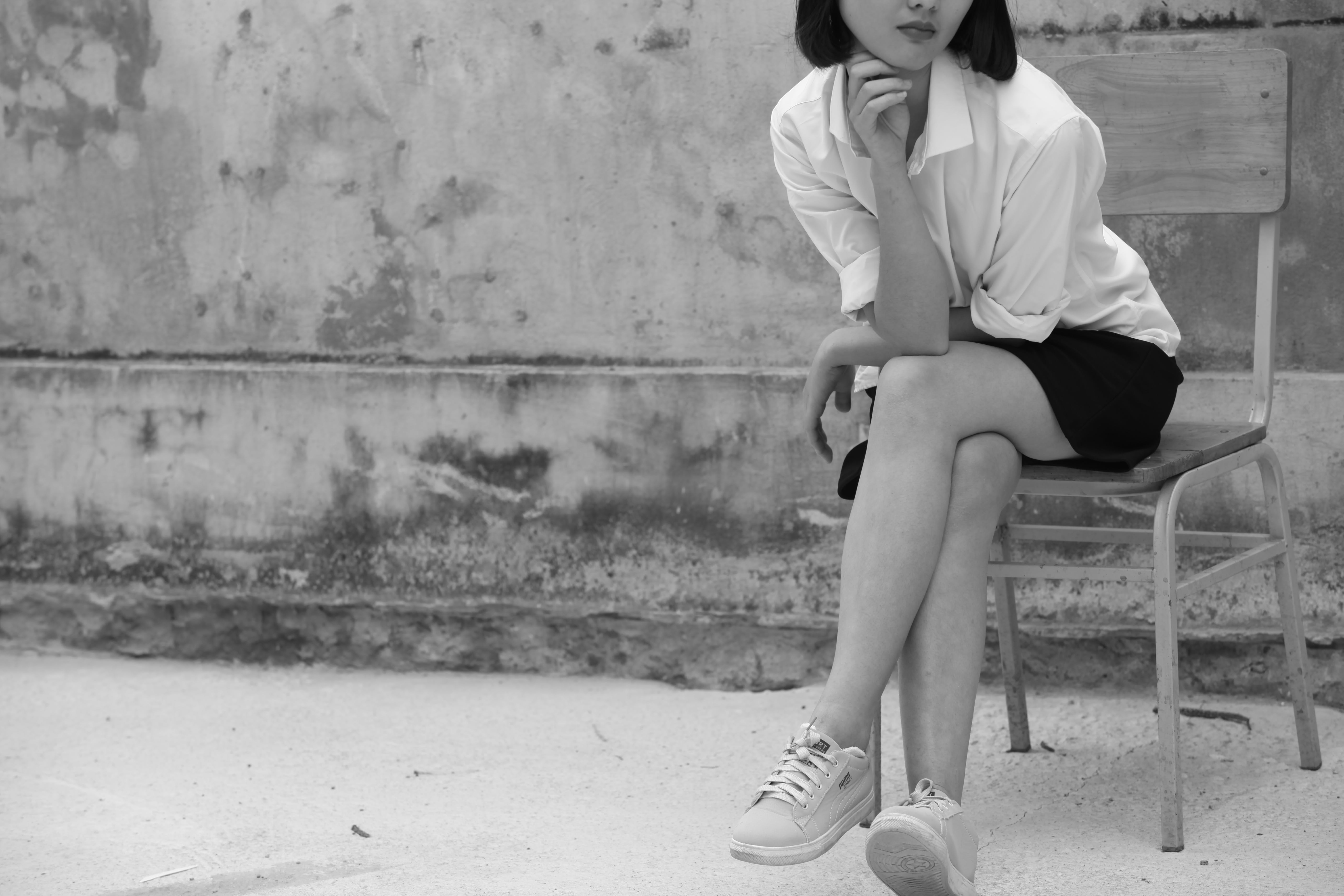 Grayscale Photography of Woman Wearing White Shirt And Black Skirt