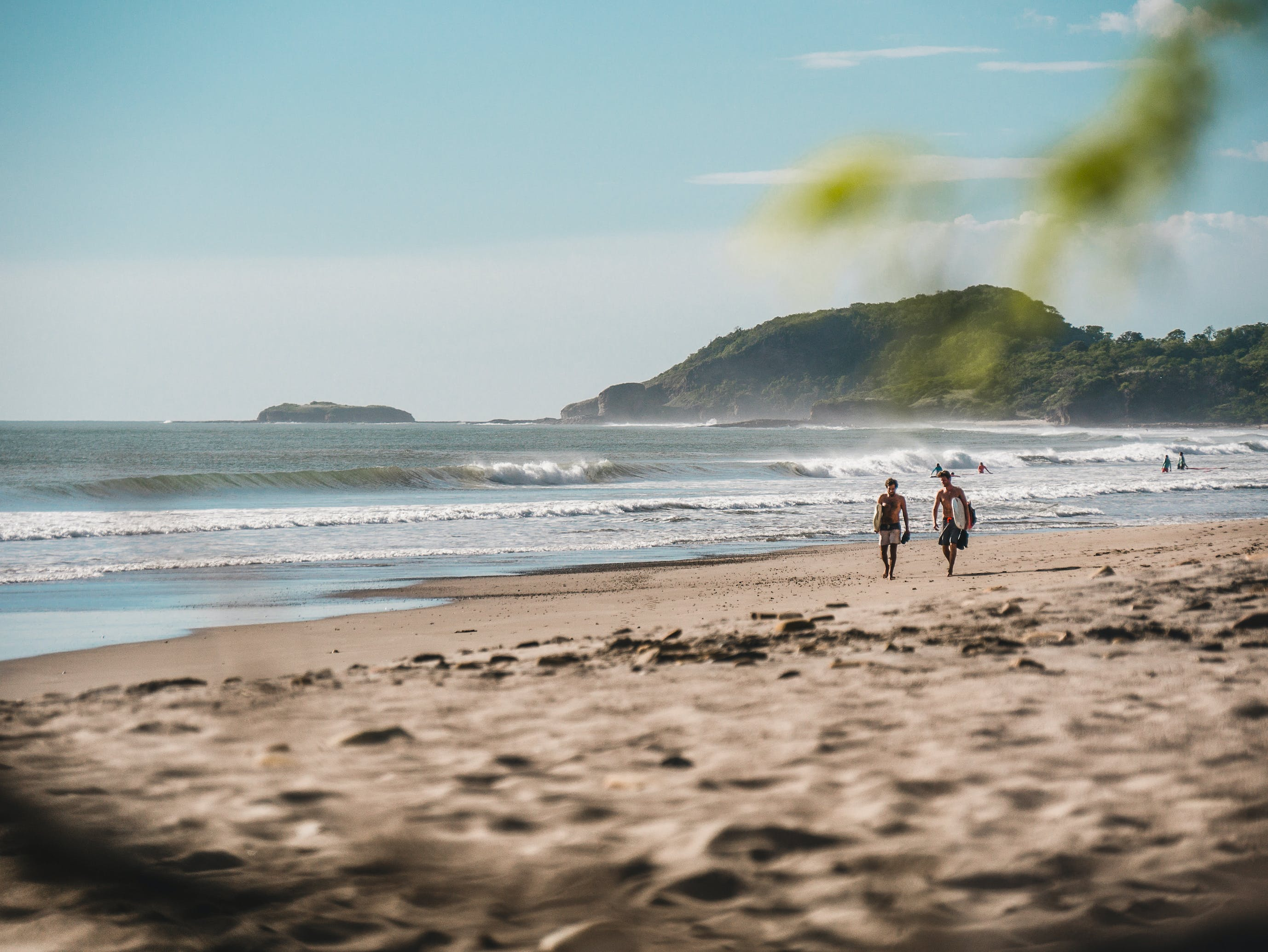 Two Person Walking on Beachside