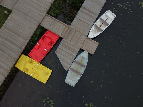 Red and Yellow Cards on Brown Wooden Table